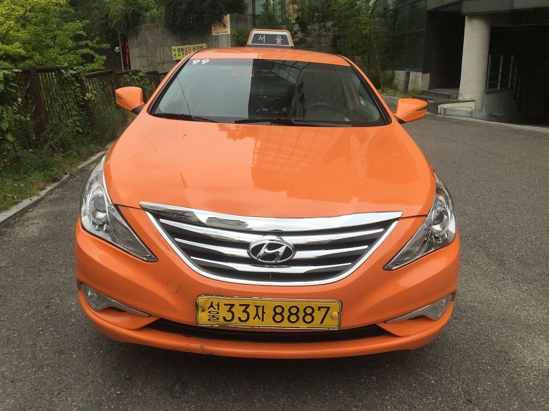 orange hyundai sonata car