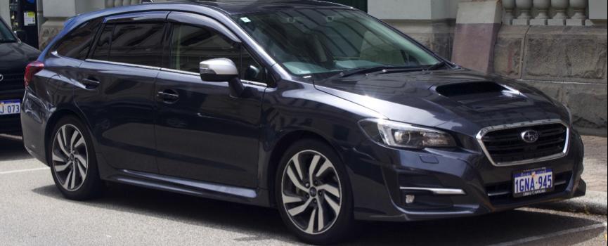 black Subaru hatchback parallel parked